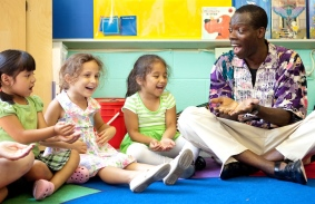 Wolf Trap Teaching Artist in the classroom with kids